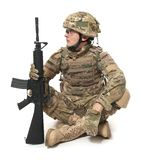 Modern soldier with rifle. Isolated on a white background Royalty Free Stock Images