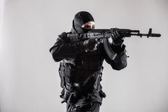 Modern soldier with rifle isolated. On a white background Royalty Free Stock Photos