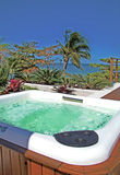 Modern spa jacuzzi. Outdoors under beautiful blue sky stock photography