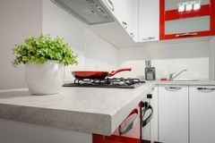 Modern red and white kitchen interior royalty free stock images