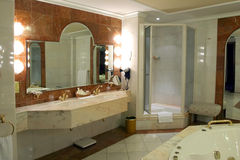 Modern and spacious bathroom. Suite designed with luxury Stock Images