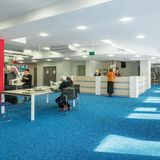 University library with blue floor. Modern and spacious university library with blue carpet on the floor stock photo