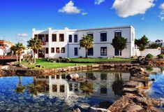 Modern Spanish building and ornamental pond Stock Photos