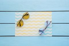 Modern spectacles situating on colorful paper royalty free stock image