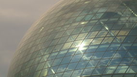Modern sphere glass building and cloudy sky reflections on it stock footage