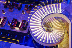 Modern spiral stairs. Illuminated by led light in a hotel luxury restaurant cafe royalty free stock photo