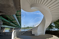 Modern spiral stairway on the bridge Stock Photos