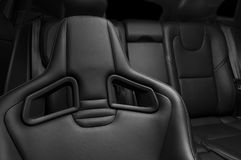 Modern sport car  black leather interior. Part of  leather car seat details Stock Images