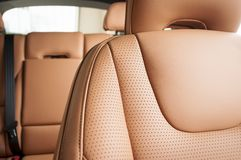 Modern sport car, seat leather details. Modern sport car interior, red perforated seat leather details on stitch Royalty Free Stock Photos