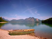 Modern sport fishing paddle boat anchored on shore royalty free stock images