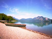 Modern sport fishing paddle boat anchored on shore royalty free stock photos