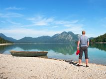 Modern sport fishing paddle boat anchored on shore stock images