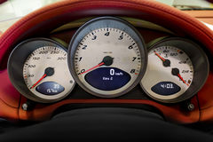 Modern Sports Car Gauges in a Leather Dash Royalty Free Stock Photos