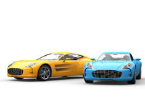 Modern sportscars side by side - blue and yellow Stock Images