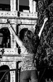 Modern sportswoman near Colosseum in Rome, Italy rejoicing Stock Photography