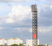 Modern spotlight pole. Of football stadium in urban city Stock Photography