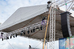Modern spotlight system mounted on outdoor stage before performa Stock Images