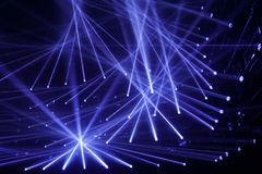 Modern spotlights, connecting blue rays of light, night club royalty free stock photos