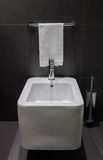 Modern square bidet in bathroom Royalty Free Stock Photo