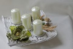 Modern square shaped advent wreath with white candles and nature decoration Royalty Free Stock Photography