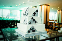 Modern square wedding cake in high tech style. An interesting and beautiful Modern square wedding cake in high tech style Royalty Free Stock Photography