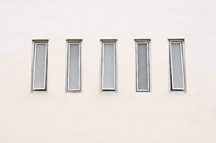 Modern Square window. On the orange wall of hotel Royalty Free Stock Photo