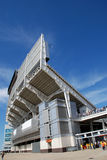 Modern Stadium. A modern stadium on game day with people watching the game Royalty Free Stock Photo