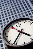 Modern stainless steel clock at canary wharf Stock Images