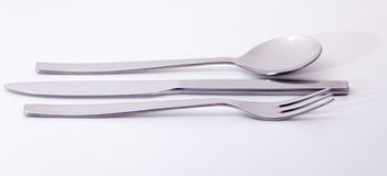 Modern stainless steel knife fork and spoon Royalty Free Stock Photo