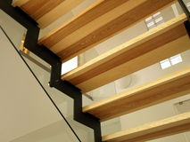 Modern staircase. Closeup of modern metal, wood and glass stairs stock photo