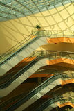 Modern staircase. Modern interior with escalators under a glass roof Royalty Free Stock Image
