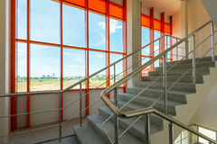 Modern staircase with beautiful window Royalty Free Stock Photo