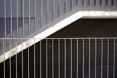 Modern staircase. The detail of a modern staircase with a railing made of stainless steel Royalty Free Stock Images