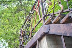 Modern staircase made of old , iron tools and parts. Modern staircase of old , iron tools and parts on a green background stock photography