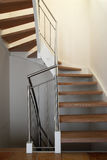 Modern stairway in house. Modern wooden staircase in house Royalty Free Stock Images