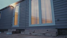 Modern static caravan. mobile House. evening time, in the windows light stock video