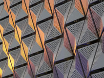 Modern steel cladding with angular geometric patterns  and squar Stock Photos