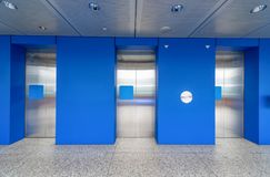 Modern steel elevator cabins in a lobby Hotel or office building Stock Photography