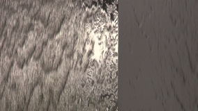 Modern steel fountain with water splash background. Modern steel wall fountain with water splash background stock footage