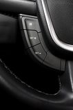 Steering Wheel commands and controls in car interior Royalty Free Stock Photo