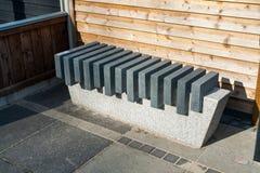 Modern stone marble garden bench. Modern style design stone marble garden park bench royalty free stock photo