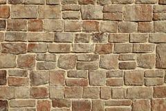 Modern Stonewall Backround textur som dekoreras med mångfärgat N Arkivfoton