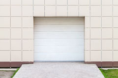 Modern storage building wall with closed white gate Royalty Free Stock Photos