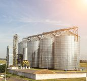Modern storage complex for oilseed rapeseed and other grains, grains, against a blue sky, silo royalty free stock images
