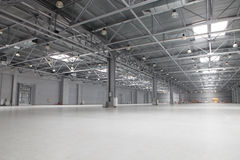 Modern storehouse. Large modern empty storehouse with windows in ceiling Stock Photos