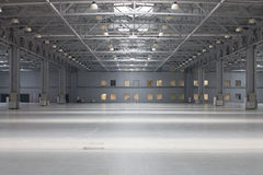 Modern storehouse. Large modern empty storehouse with windows in ceiling Stock Images