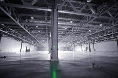 Modern storehouse. Large modern dark  empty storehouse Royalty Free Stock Photos