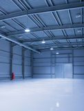 Modern storehouse. Empty room of modern storehouse with gates Royalty Free Stock Photos