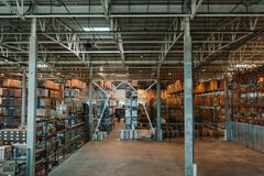 Modern storehouse interior with boxes and containers. On shelves Stock Image