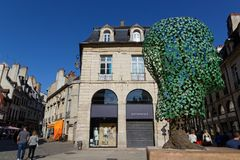 Modern stores and old architecture. DIJON, FRANCE, May 20, 2018 : Modern stores and old architecture in the heart of the preserved old center of the city Royalty Free Stock Photos